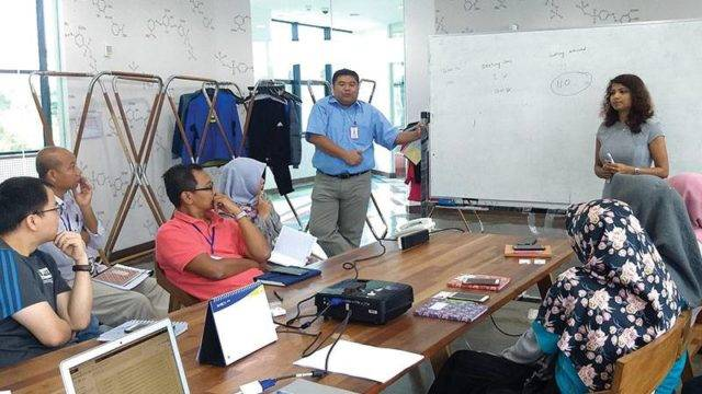 IntelloCut project manager training the Pan Brothers team