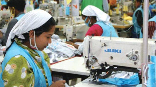 Woman working on a sewing machine in Epyllion factory in Bangladesh