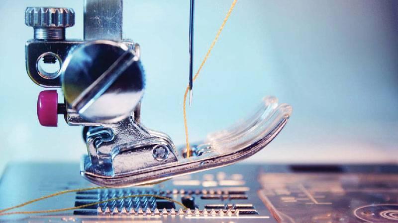 Hình ảnh chân vịt và kim của một chiếc máy may