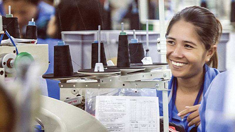 Woman worker working on a sewing machine in Sabrina factory, Taiwan