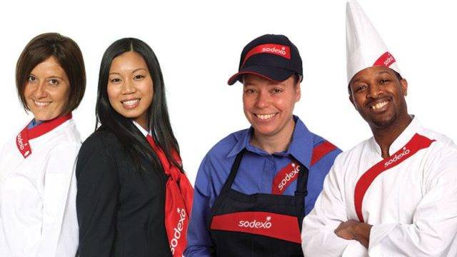 Professionals wearing Sodexo uniforms