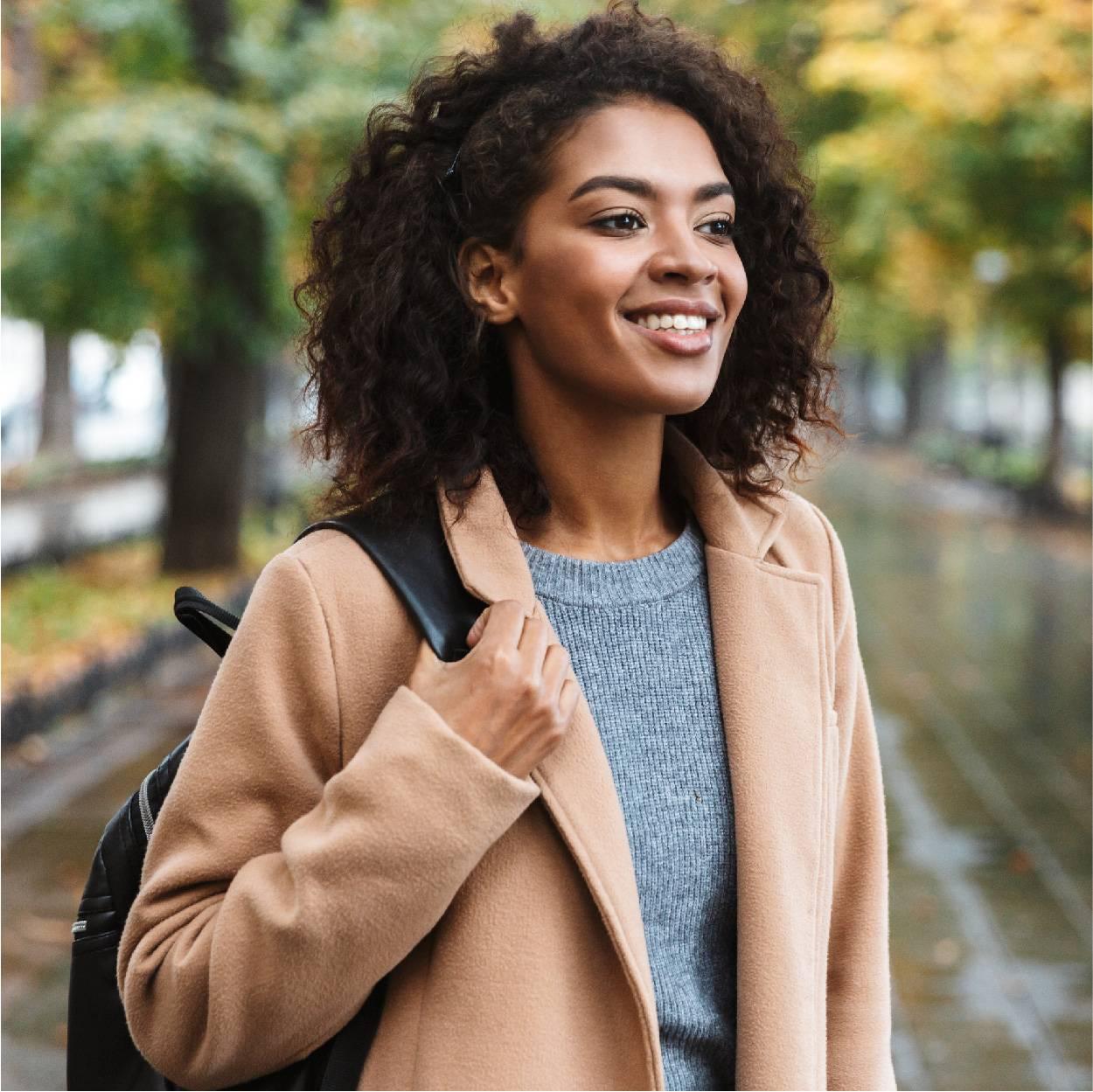Female wearing coat in woords