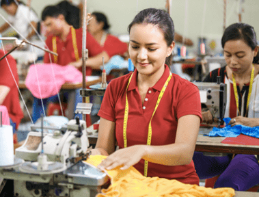 Portrait of professional Seamstress in textile factor